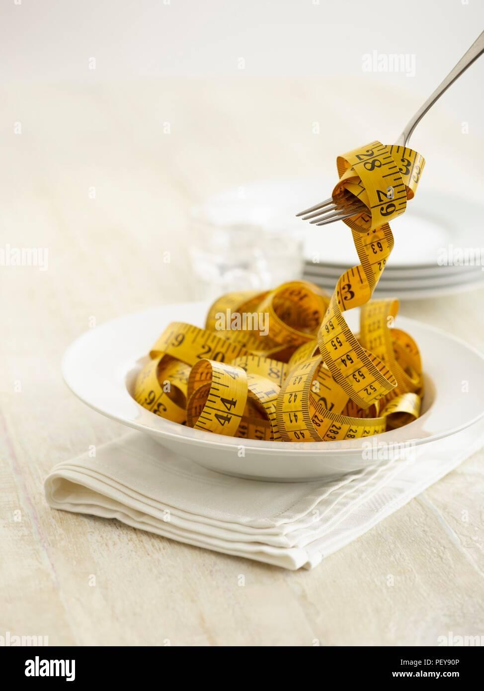 Pasta Schüssel mit Maßband. Stockbild