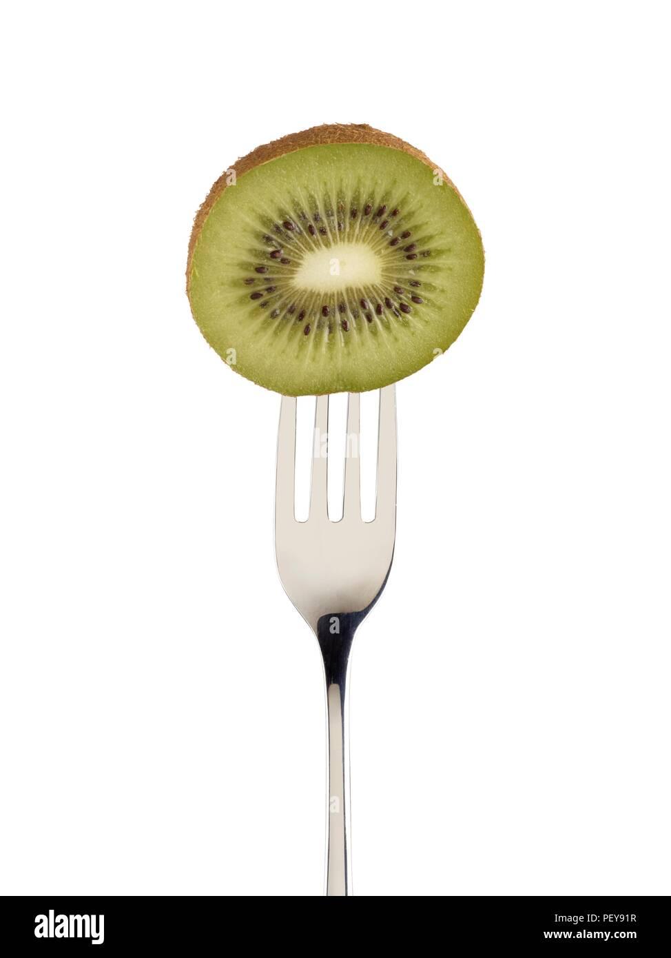 Kiwi in der Hälfte auf eine Gabel. Stockbild