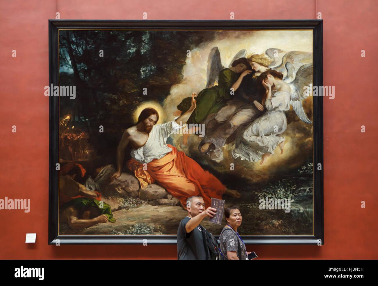 """Besucher vor dem Gemälde """"Christus am Ölberg"""" durch die Französische romantische Maler Eugène Delacroix (1824) bei seiner Retrospektive im Musée du Louvre in Paris, Frankreich angezeigt. Die Ausstellung, die Meisterwerke der Führer der französischen Romantik läuft bis 23. Juli 2018. Stockbild"""