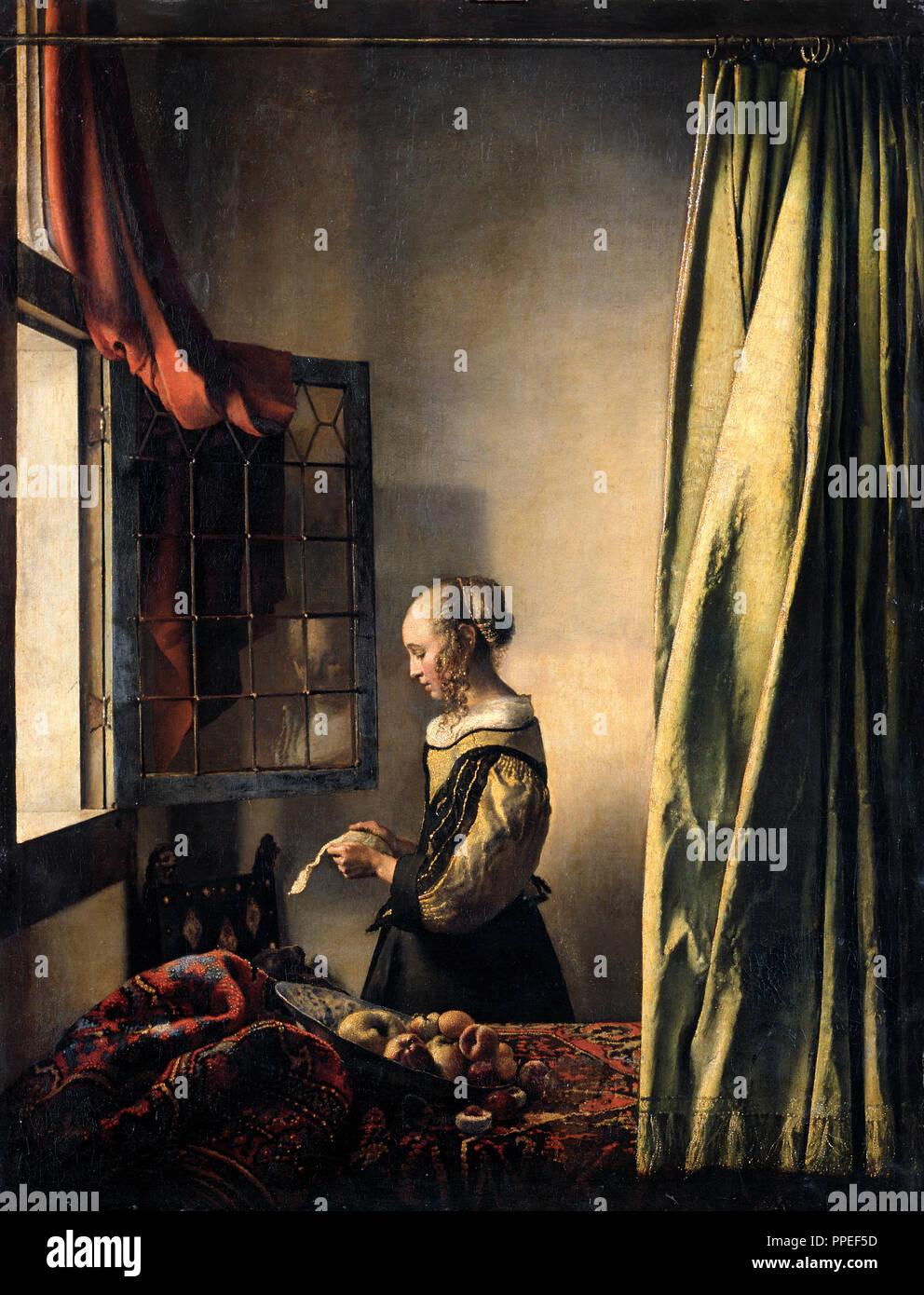 Johannes Vermeer - Mädchen Lesen eines Briefes durch ein offenes Fenster. Circa 1659. Öl auf Leinwand. Gemaldegalerie Alte Meister, Dresden, Deutschland. Stockbild