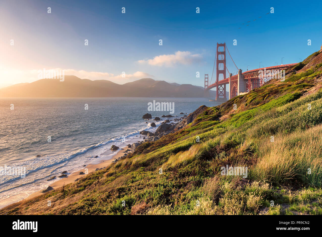 Küste von Kalifornien - Golden Gate Bridge bei Sonnenuntergang in San Francisco Stockbild