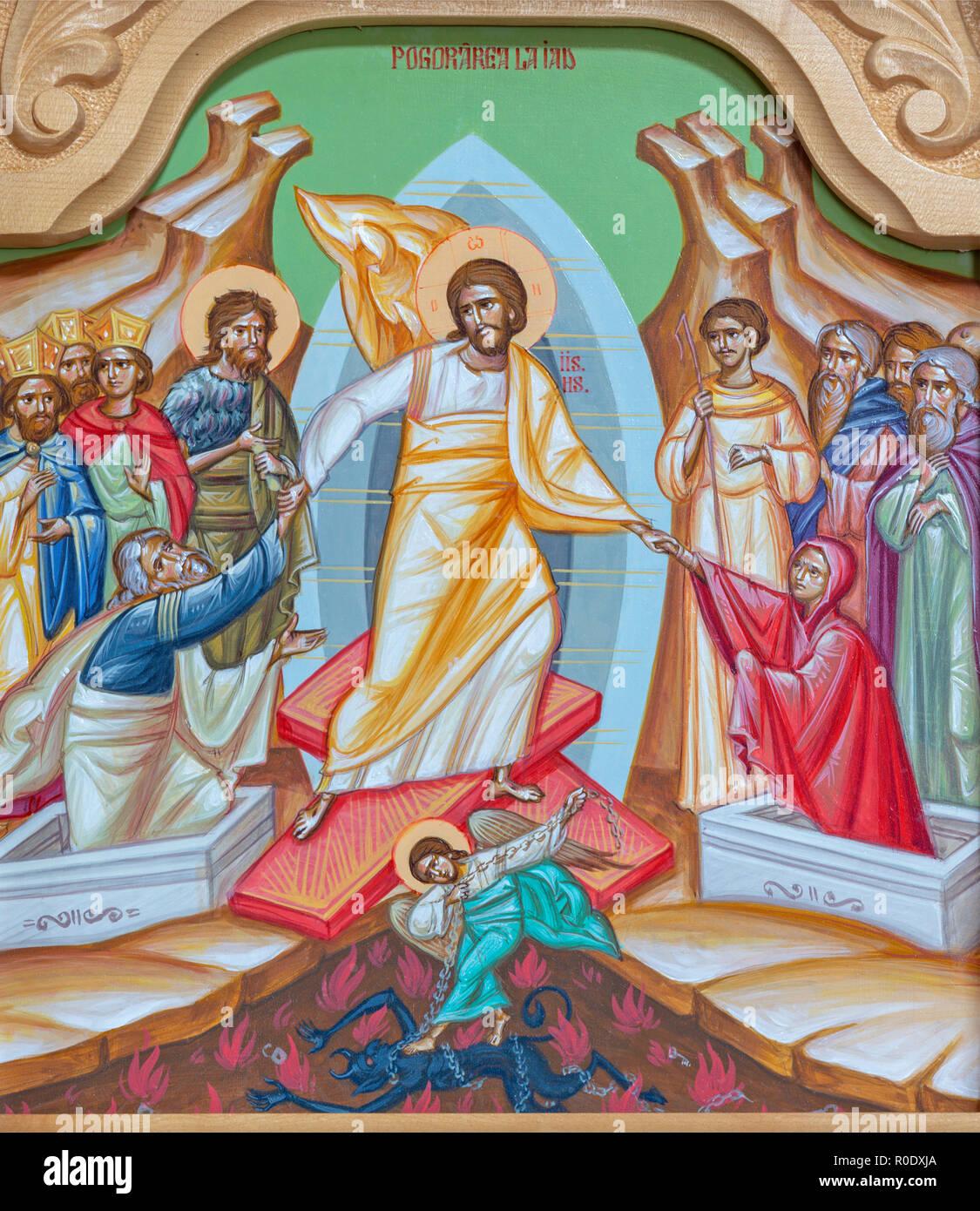 """Reggio Emilia - das Symbol der """"Harrrownig der Hölle - descensus Christi und Inferno (lateinisch)' auf der Ikonostase in der Kirche Chiesa di San Giorgio. Stockbild"""