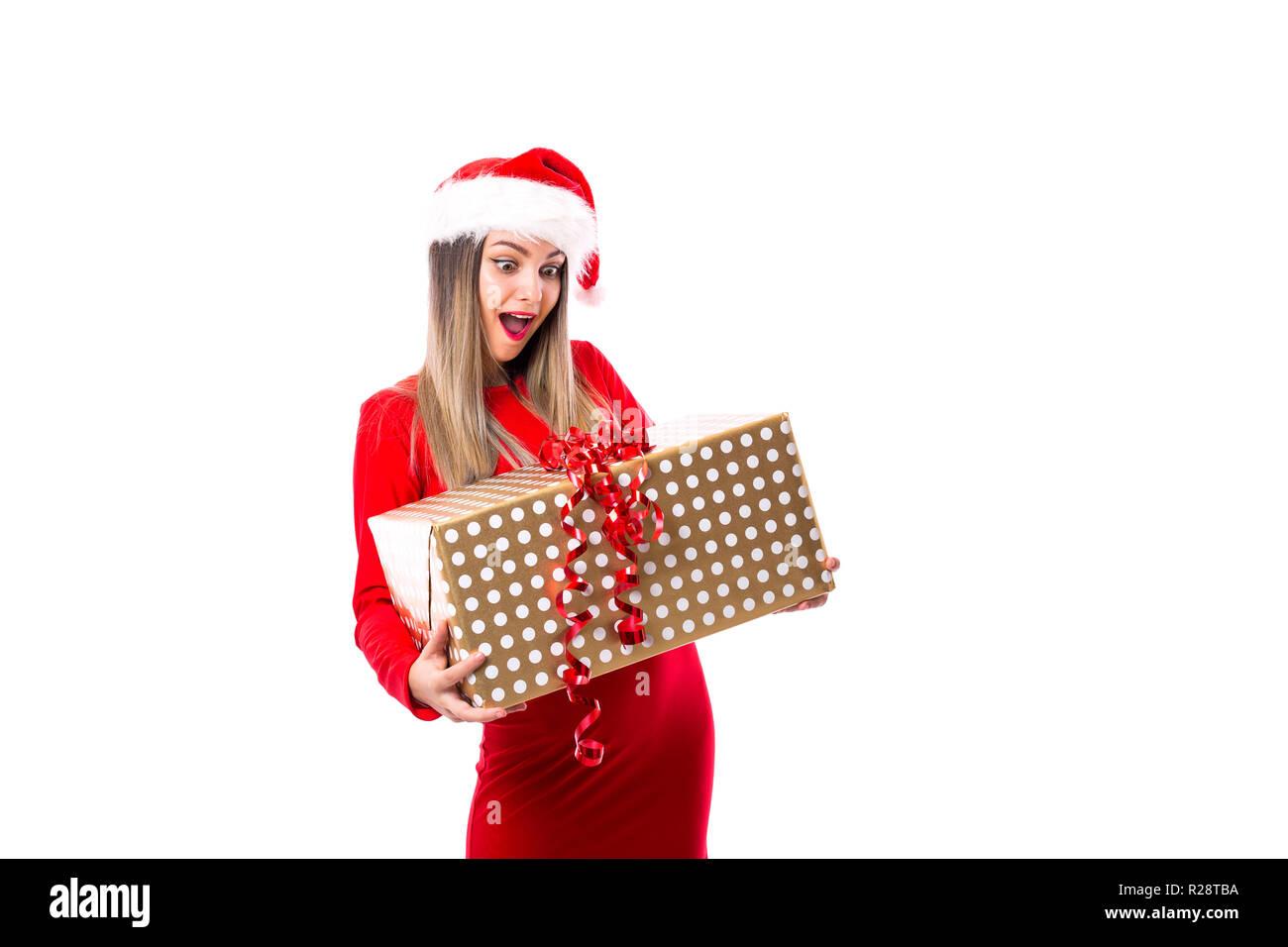 Junge Frau eine große Zeit über weiße Holding aufgeregt. Der Weihnachtszeit. Stockfoto