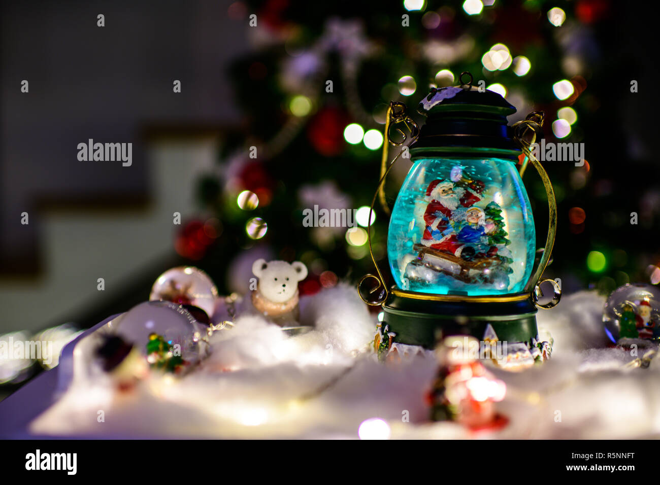 3d white people inside of a christmas gift in snow dome. 3d renderer image.  white people inside of a christmas gift in snow