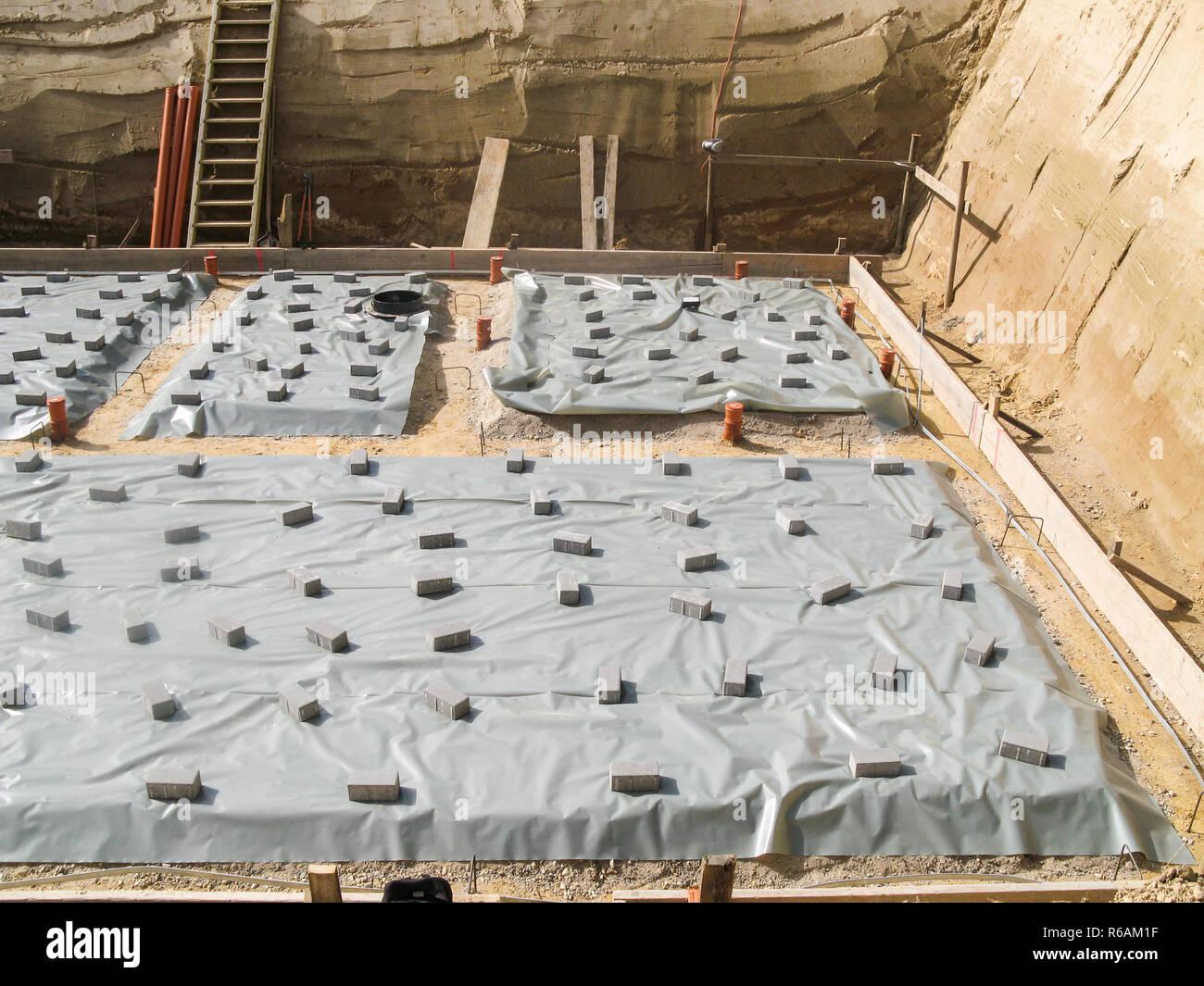 Ein Haus vorbereiten einen Betonsockel In einer Ausgrabung Stockfoto