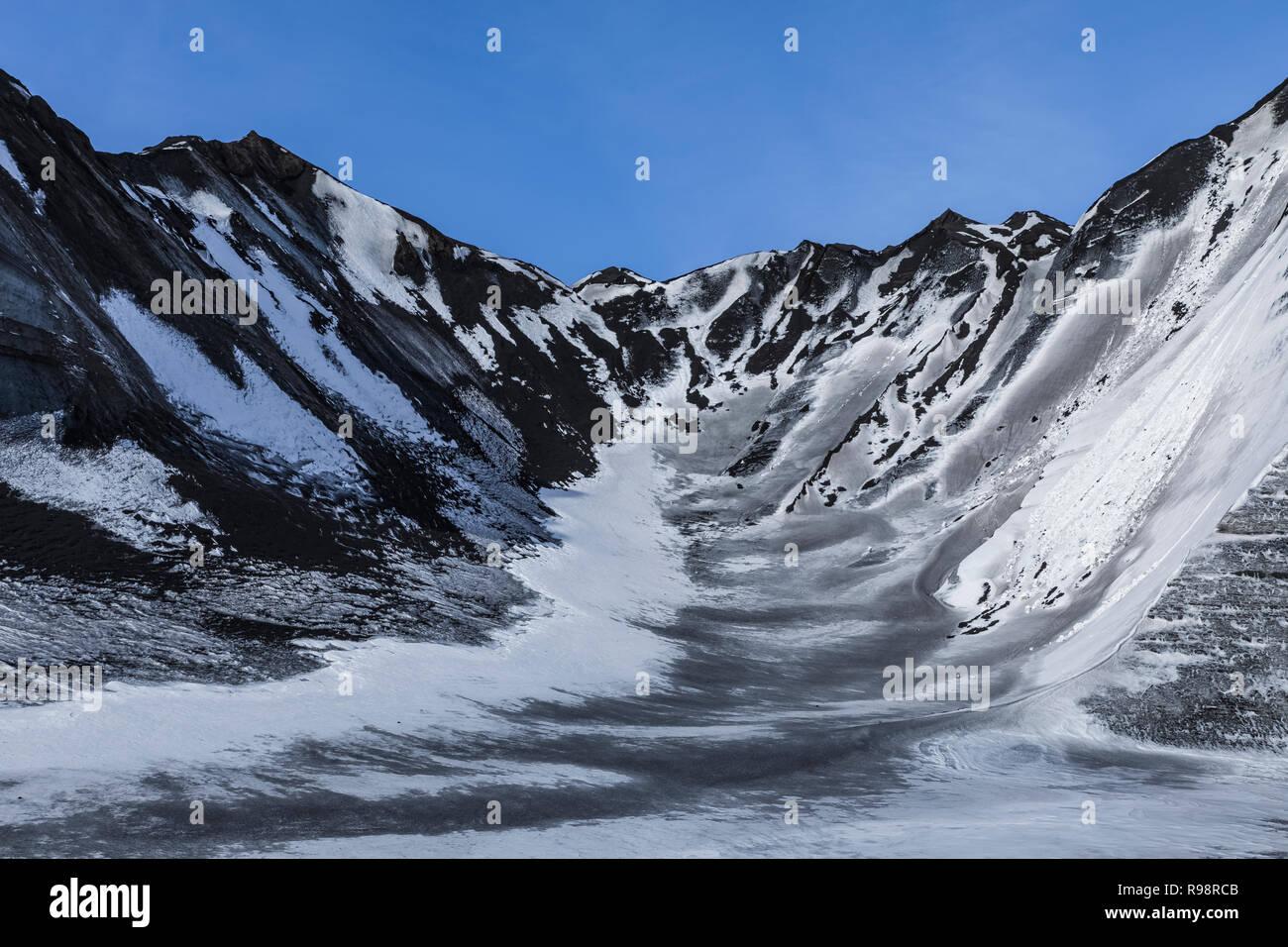Endstation der Gletscher Ice Cave Tour zu einer Nocke der Gletscher Myrdalsjökull, die auf Katla Vulkan sitzt gesehen, im Winter in Island Stockfoto