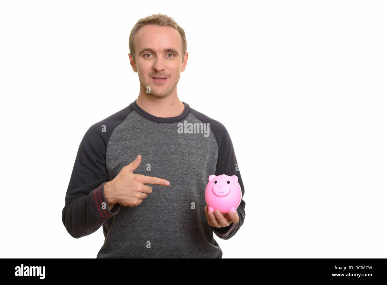 Stattlichen kaukasischen Mann, Sparschwein und Zeigefinger Stockfoto