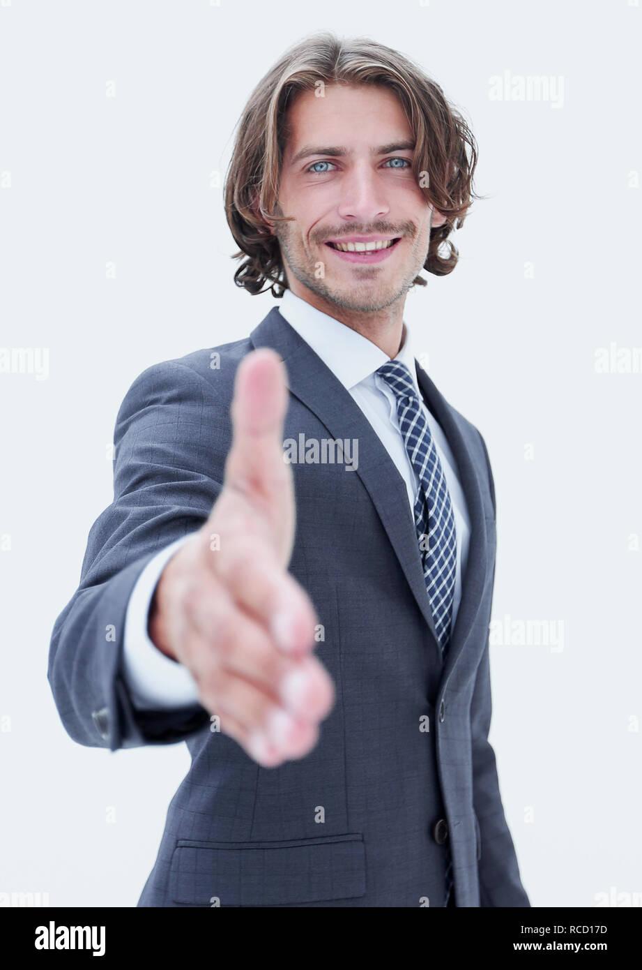 Freundlich lächelnd Geschäftsmann bietet einen Handshake Stockbild