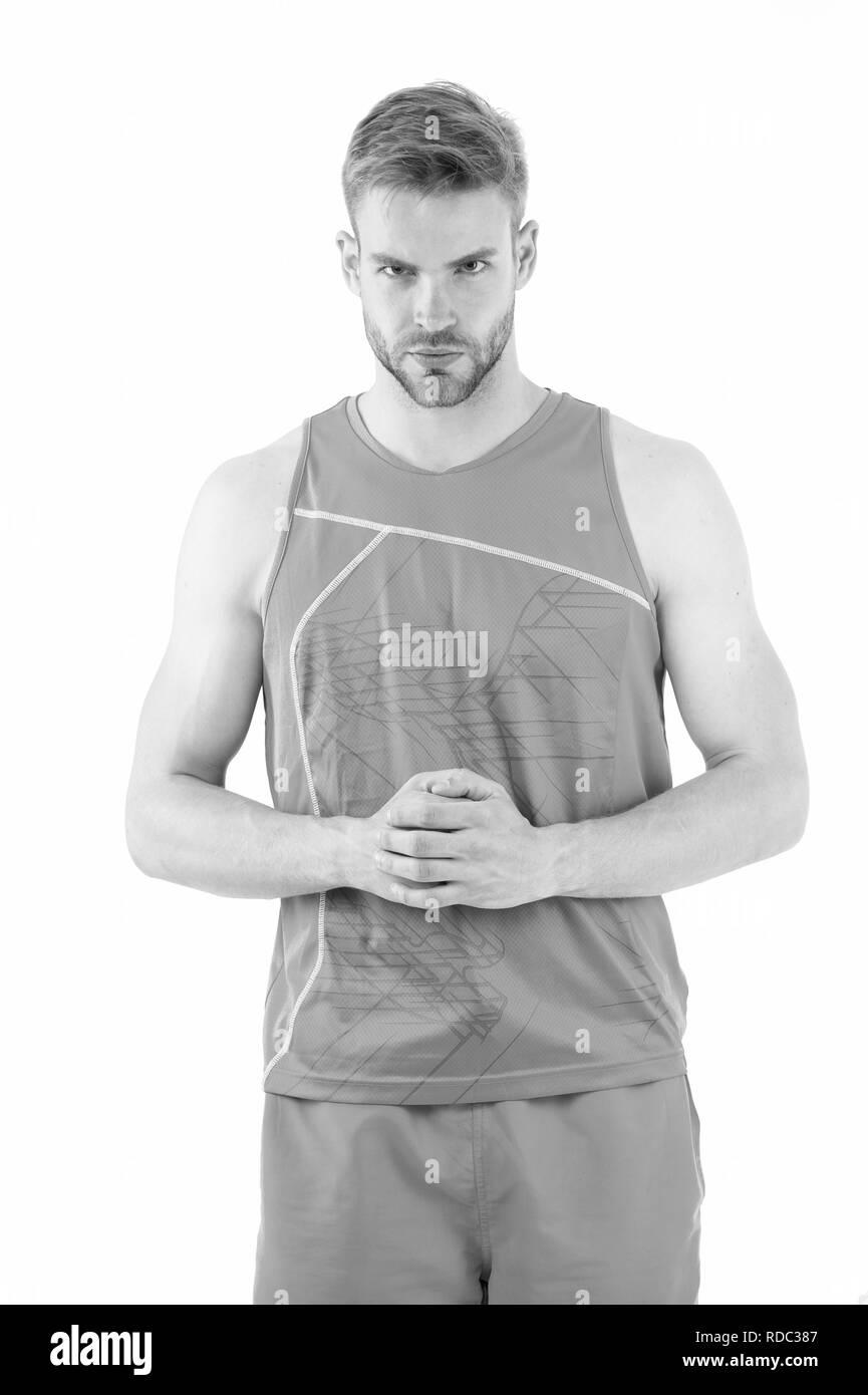 Sport ist die Art und Weise seines Lebens. Mann sportliches Outfit sieht ernste und strenge weißen Hintergrund. Guy muskulösen Körper gesund Leben sportlicher Lifestyle. Sportler seinen muskulösen Körper stolz auf sich. Stockbild