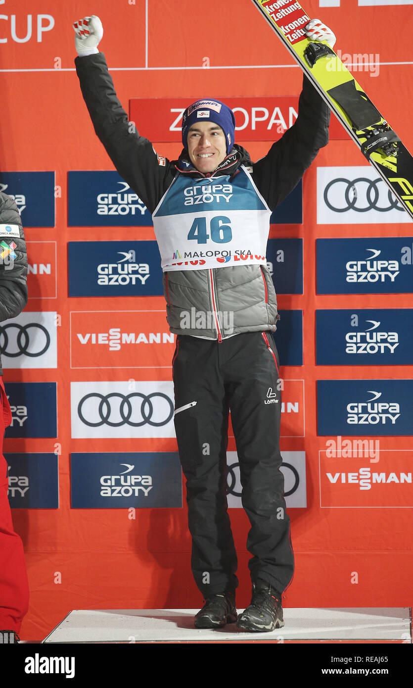 Stefan Kraft gesehen feiern, nachdem er die einzelnen Konkurrenz der FIS Skisprung Weltcup in Zakopane. Stockfoto