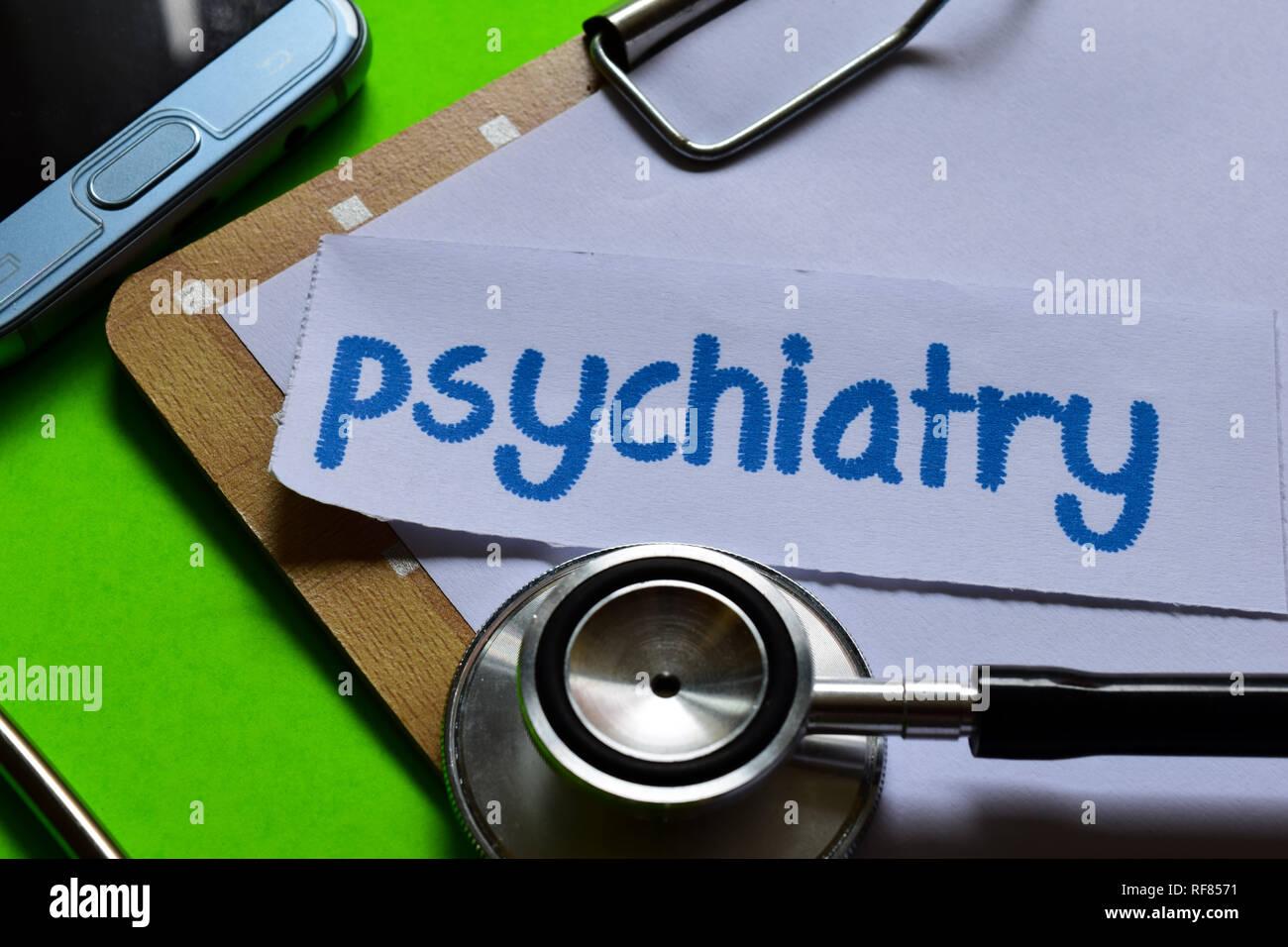 Psychiatrie im Gesundheitswesen Konzept Inspiration mit grünem Hintergrund Stockbild