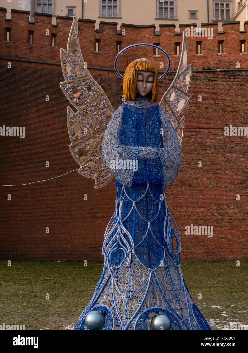 Weihnachtsbeleuchtung Engel.Engel Weihnachtsbeleuchtung Krakau Polen Stockfoto Bild