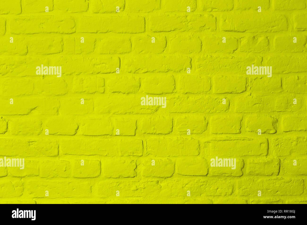 Pastellfarben helles zitronengelb gefärbten Stein Steinmauer, Vollbild, Bild Hintergrund Stockbild