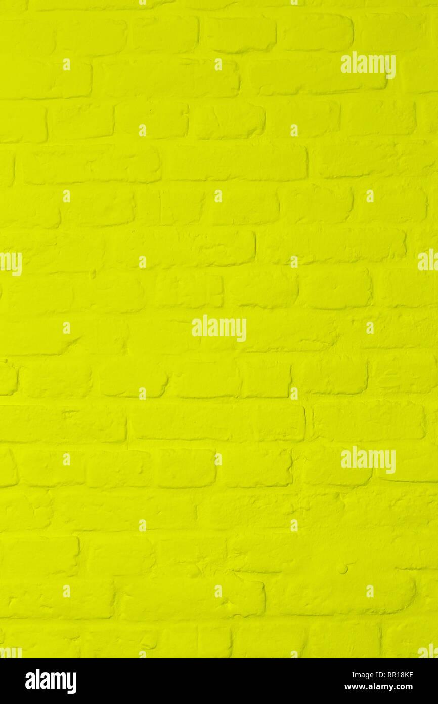 Pastellfarben helles zitronengelb gefärbten Baustein Wand, Vollbild, Bild Hintergrund Stockbild