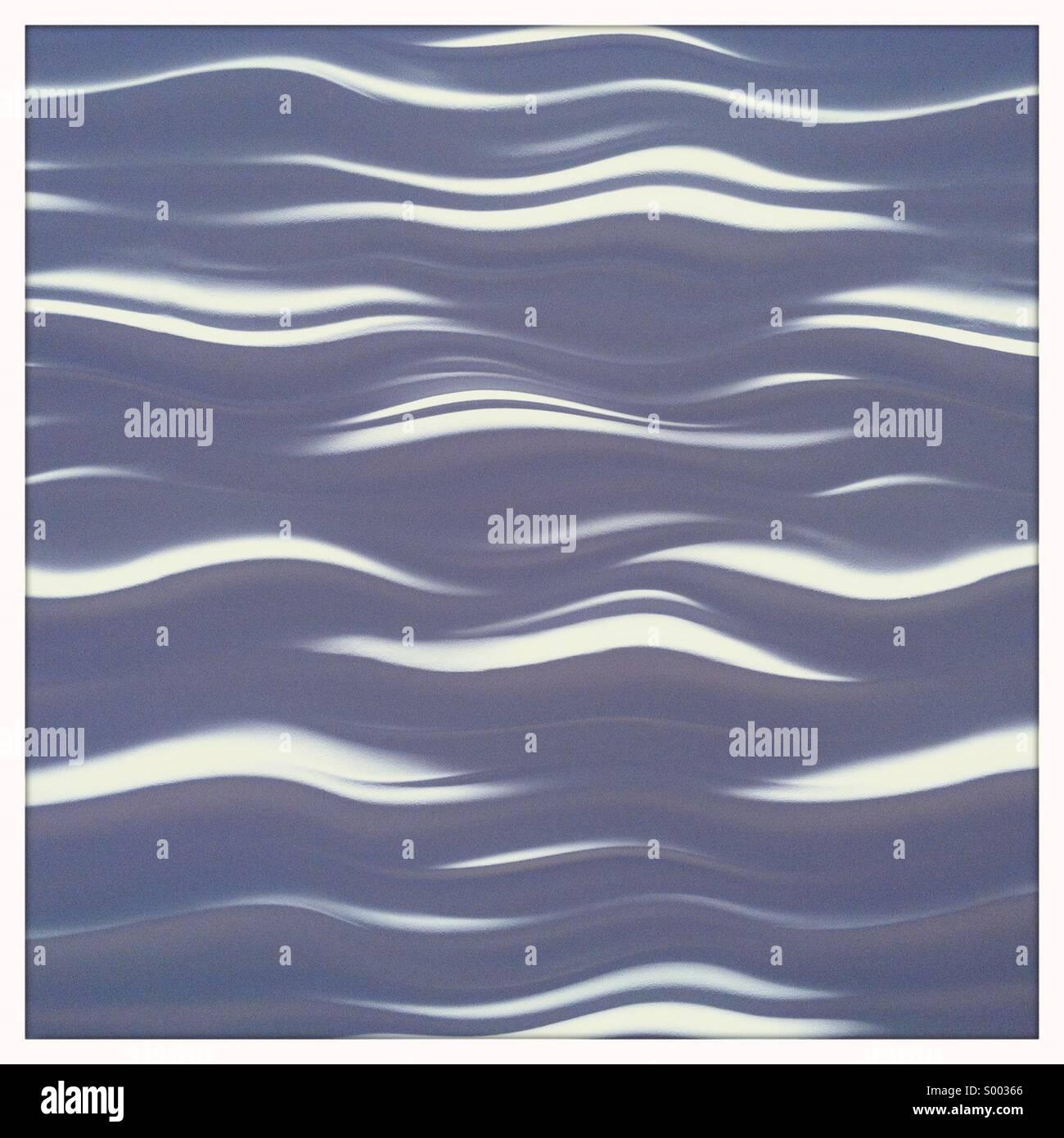 Ein Muster von weichen weißen Wellen Stockbild