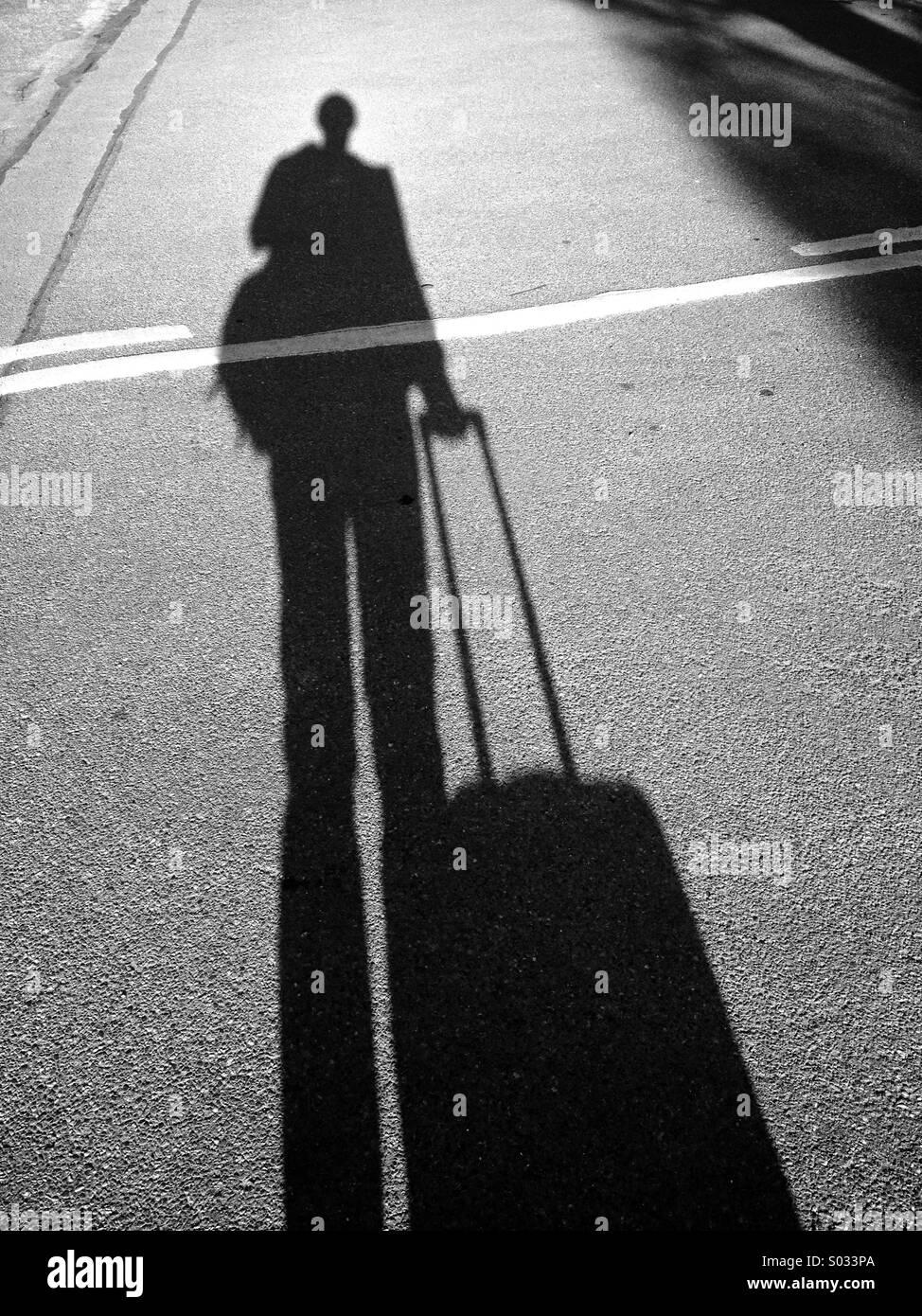Lange Schatten mit Tasche Stockbild