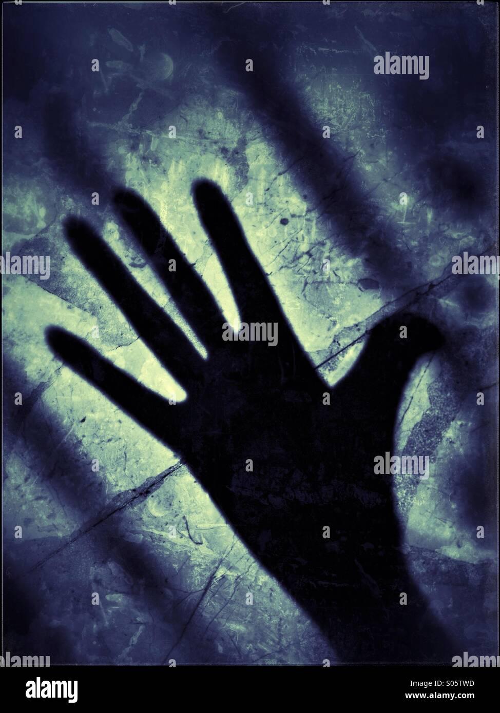 Längliche Schatten einer Hand. Stockbild