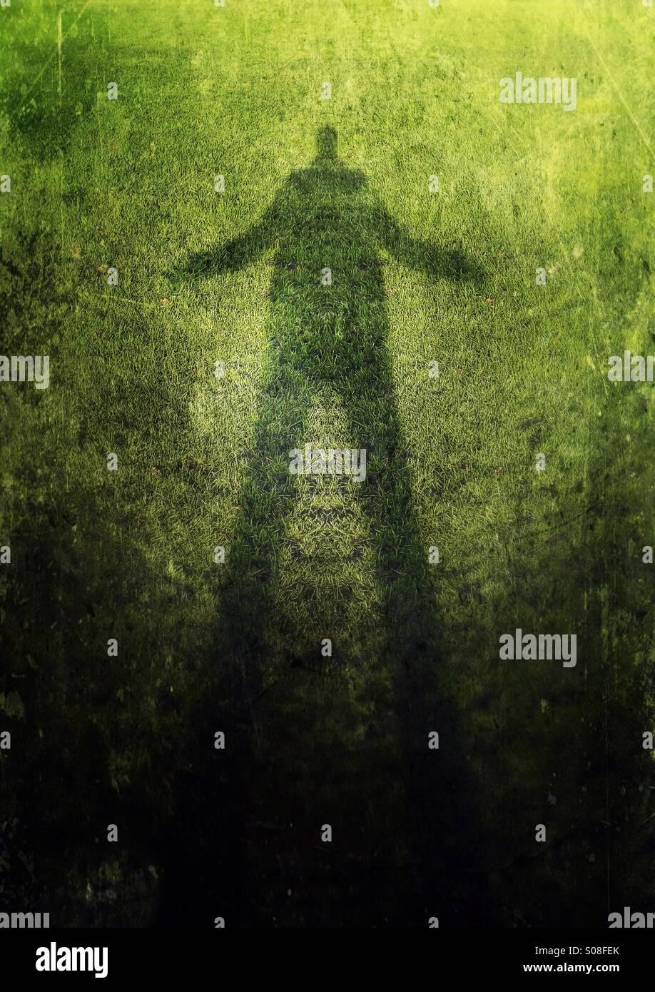 Grüner Mann - Schatten eines Mannes Stockbild