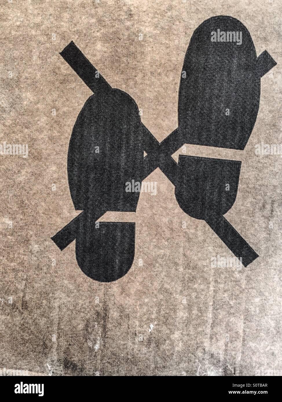 """Piktogramm Darstellung """"nicht step'with Schuhabdrücke und ein X Stockbild"""