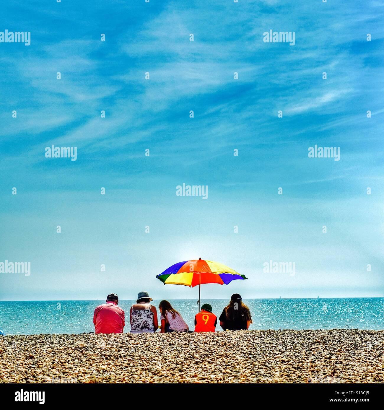 Einen Familien Strandurlaub Stockbild