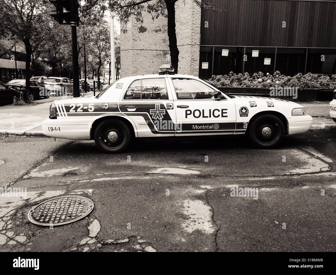 Polizei-Auto auf der Straße Stockbild
