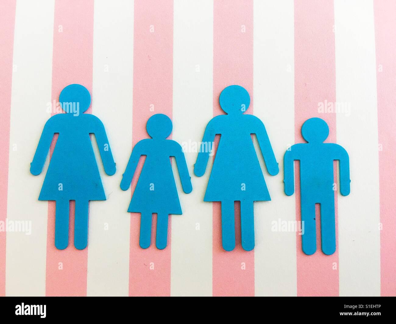 Eine Aufstellung von drei weiblichen Geschlechts Silhouetten und ein Männchen. Stockbild