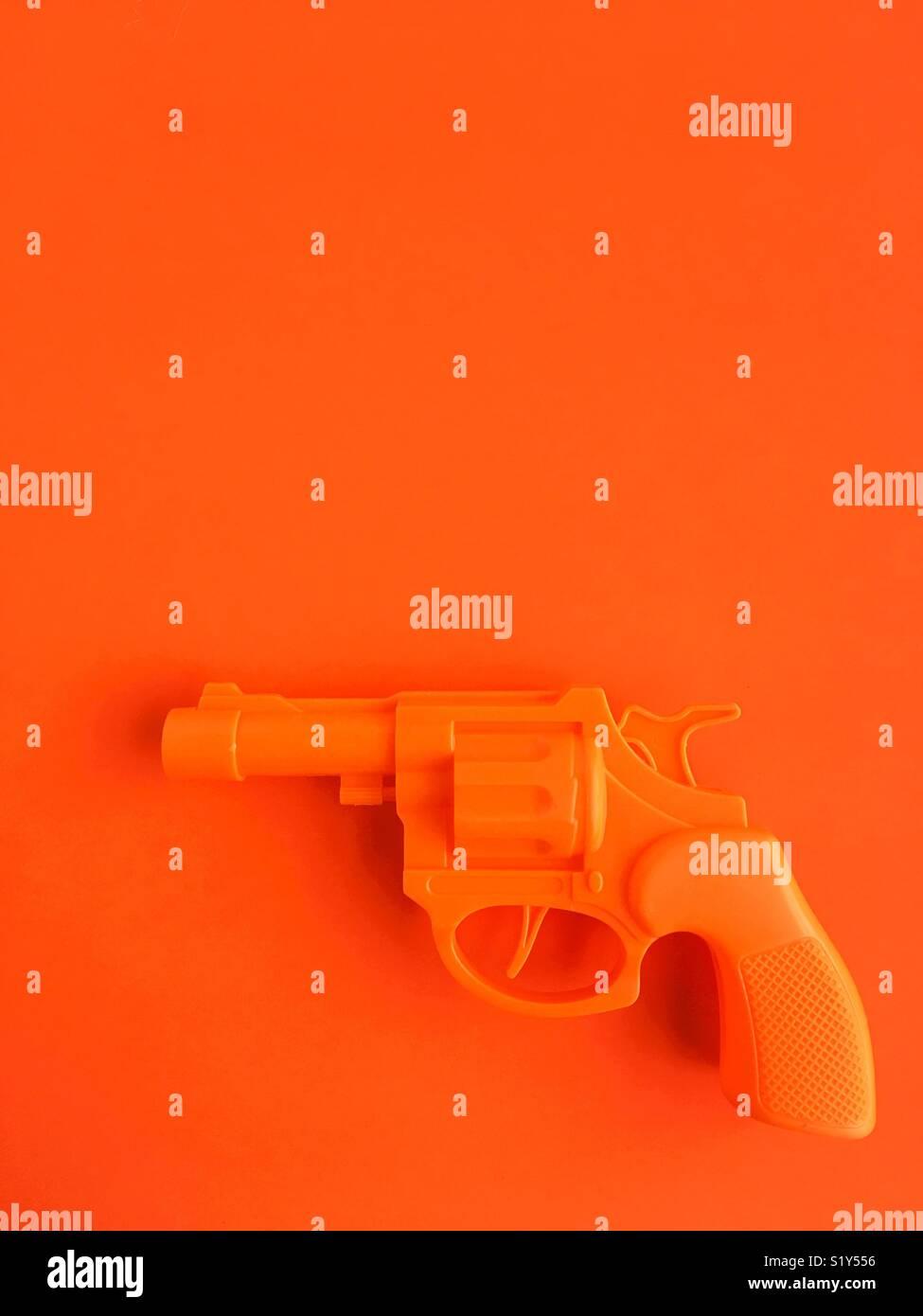 Eine Spielzeugpistole. Stockbild