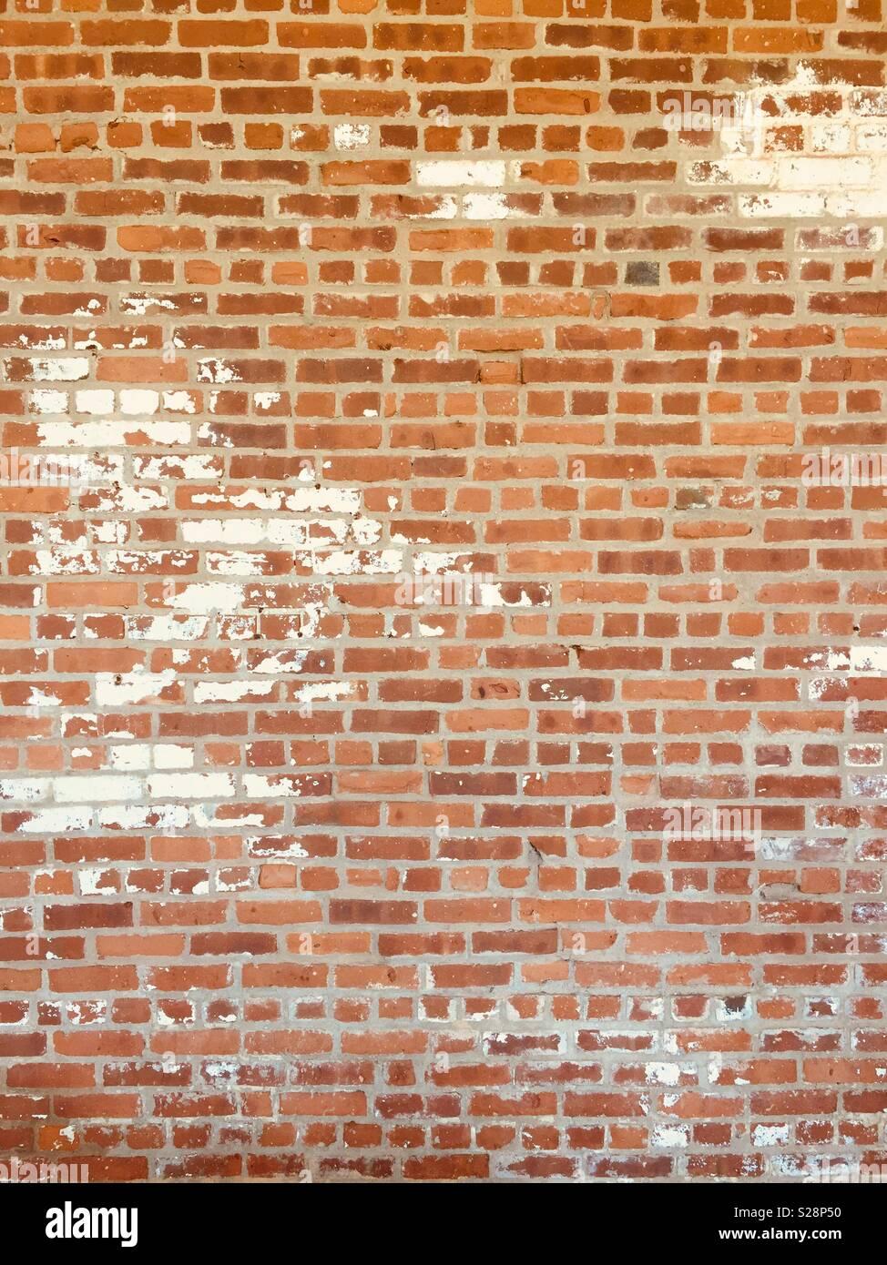 Brick Wall mit einigen Beschädigungen Stockbild