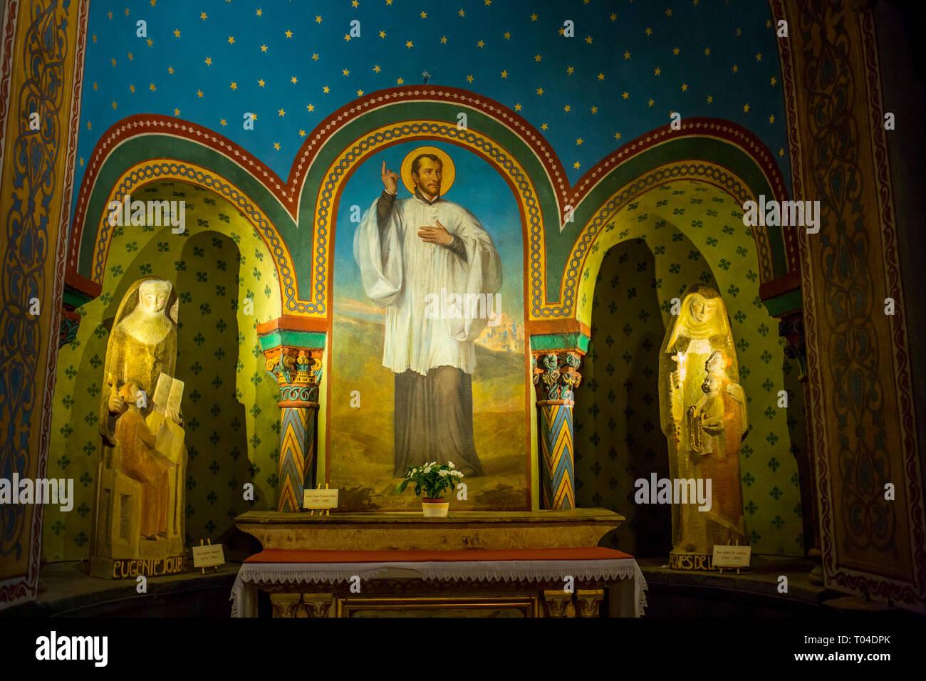 Gemälde von St. Francois Regis und Statuen von Eugenie Jaubert und Agnes de Langeac in der Kathedrale Notre Dame du Puy in Le Puy-en-Velay in Frankreich Stockbild