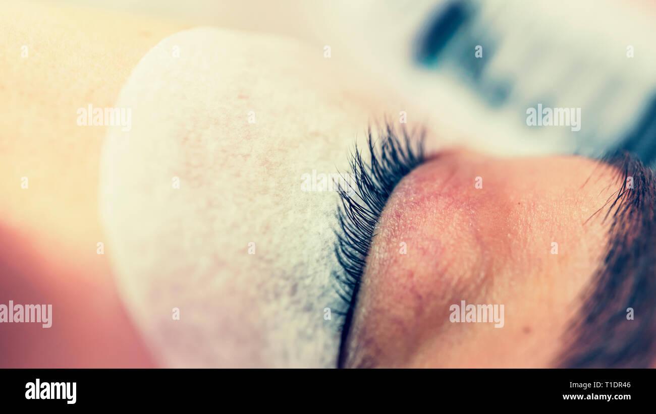 Eyelash Extensions, geschlossene Augen, Wimpern, künstliche Wimpern, Erweiterungen, Wimpern, Auge, Beauty Salon, Make-up, Stockbild