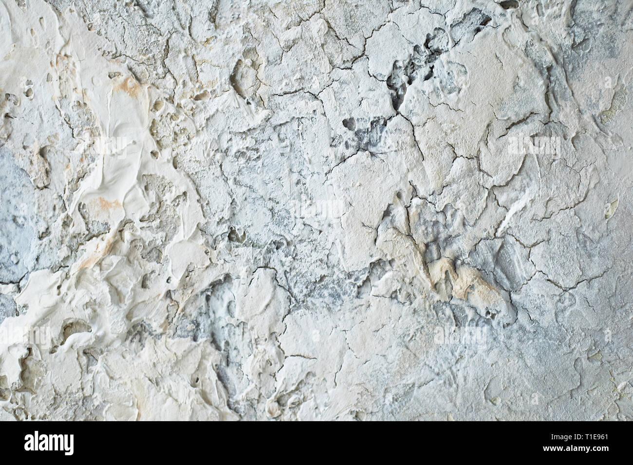 Stuck auf einer weißen Wand mit alten Putz. Textur Stockbild
