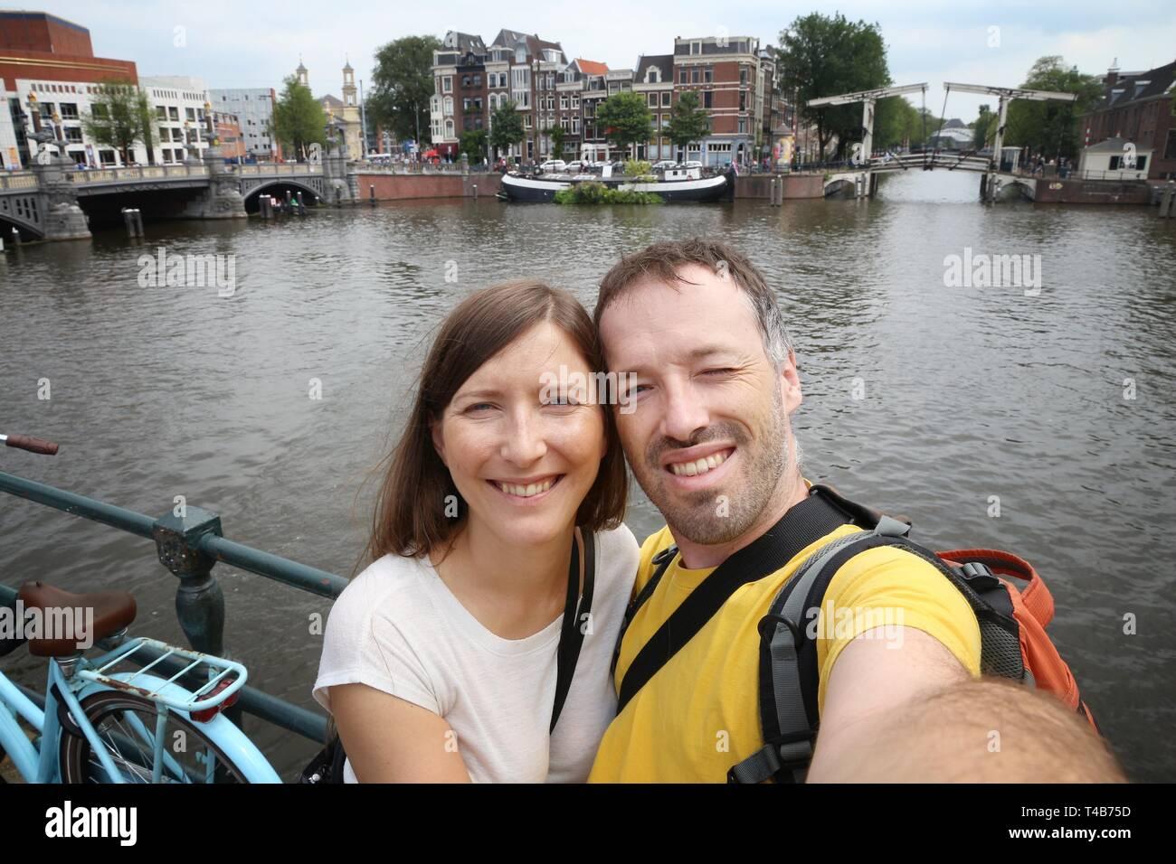 Amsterdam Tourist selfie - Wochenendbesuch in den Niederlanden. Stockbild