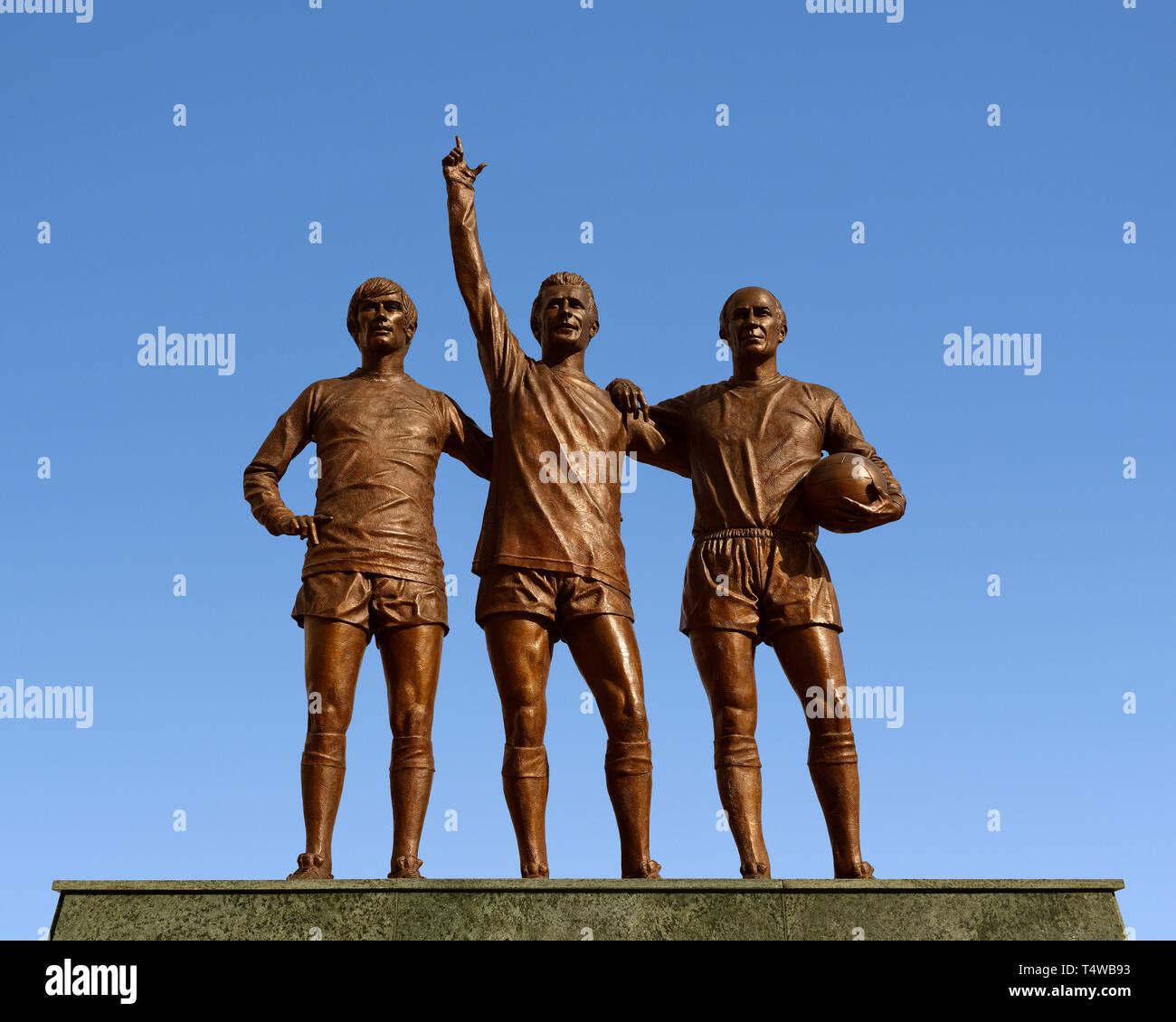 Manchester United Holy Trinity Statue außerhalb des Stadion Old Trafford, Manchester, England, Vereinigtes Königreich Stockbild