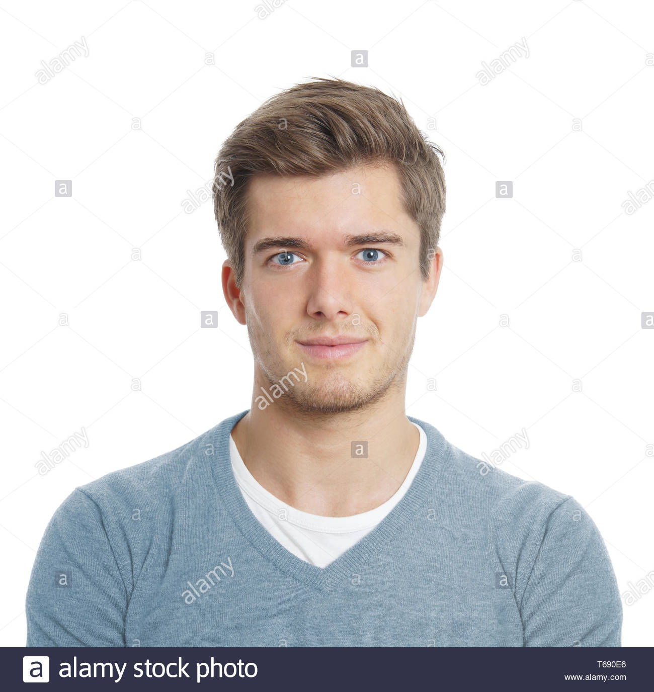 junger Mann sucht zufrieden Stockbild