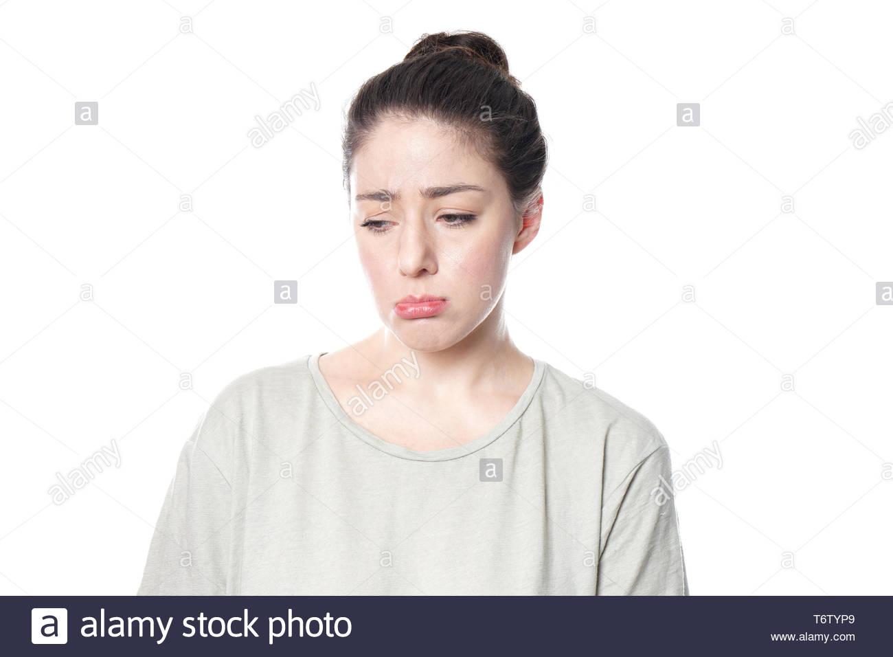 Sulky schmollen, junge Frau, die kindliche Stockbild