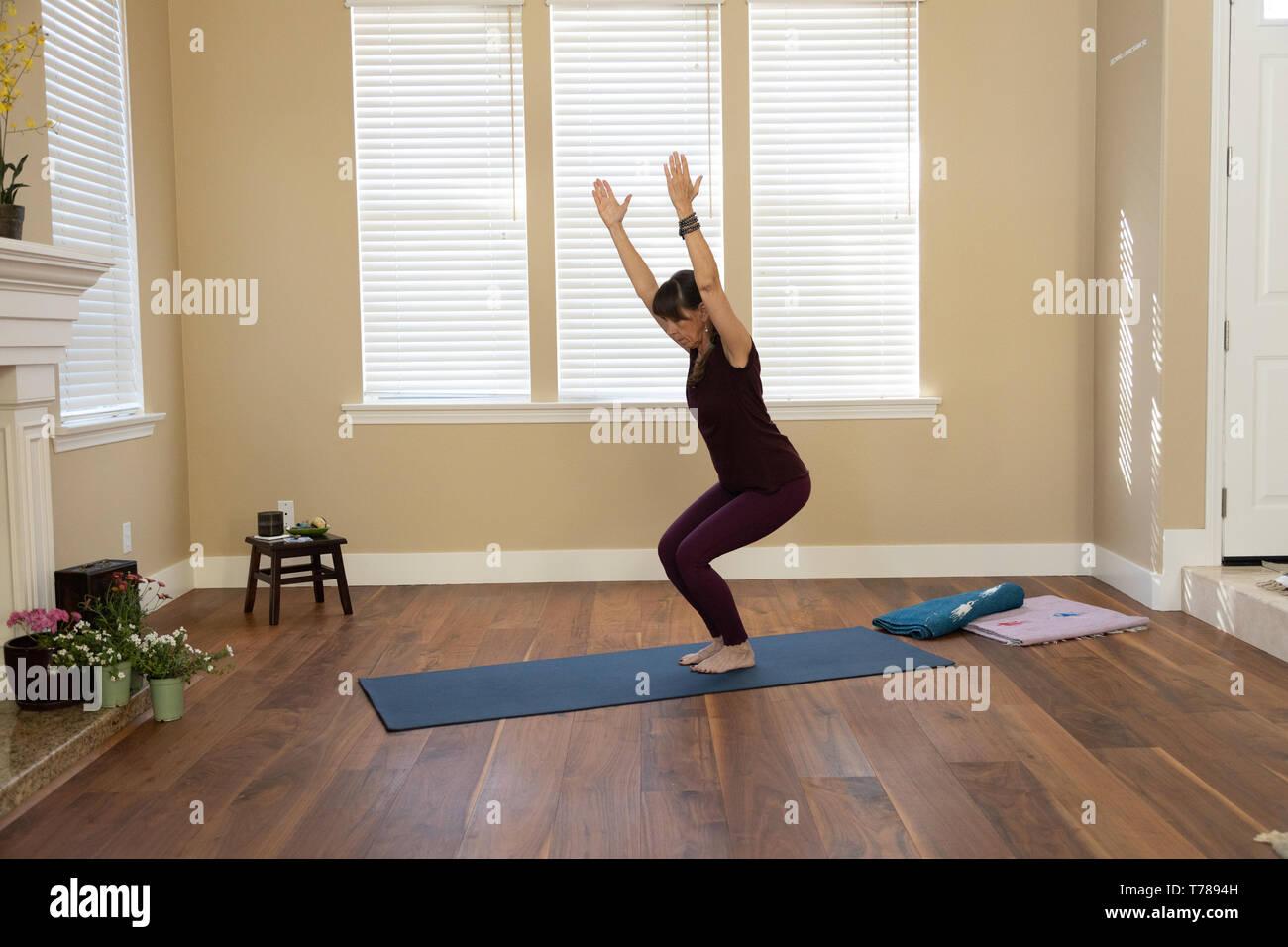 Yoga Hocke Stockbild