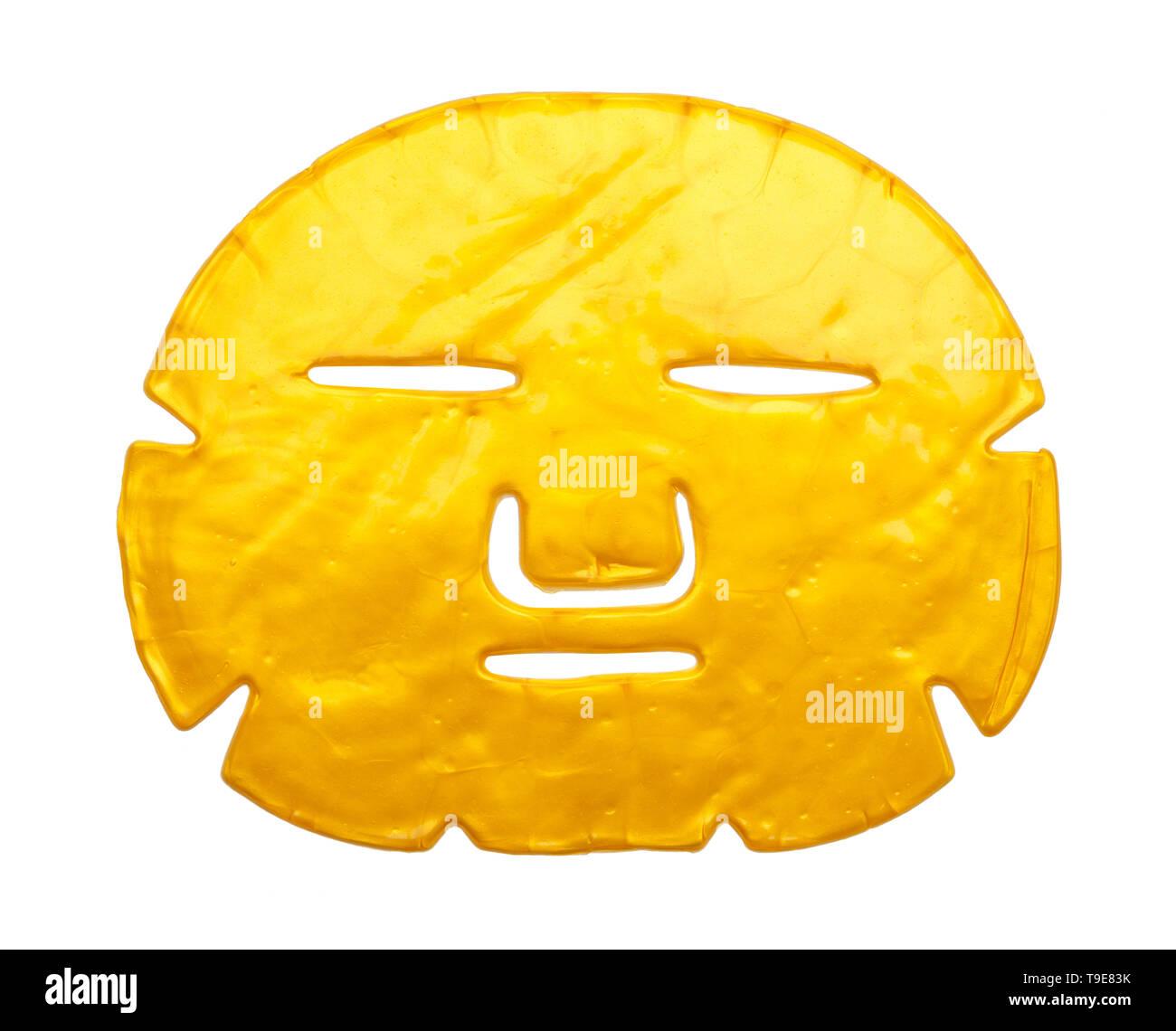 Gold Gesichtspflege Maske isoliert auf weißem Hintergrund. Stockbild