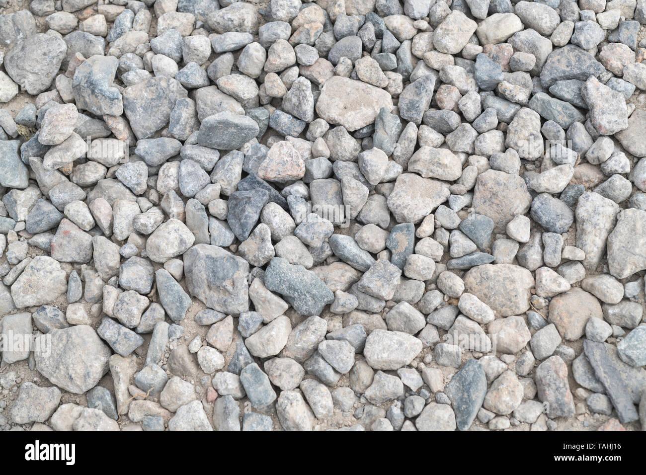 Verdichteter Stein hardcore Oberfläche - Metapher rau, holperig, rau, auf steinigen Boden fallen, holprigen Fahrt holperig. Stockbild