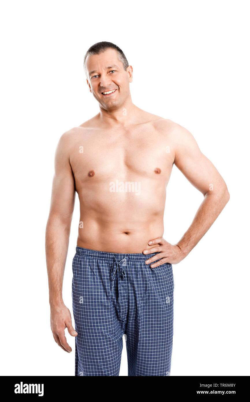 Mann mittleren Ändert in Schlafanzughose mit nacktem Oberkoerper, Deutschland | schöner Mann im Pyjama Hose mit nackten Oberkörper, Deutschland | BLWS 48 Stockbild