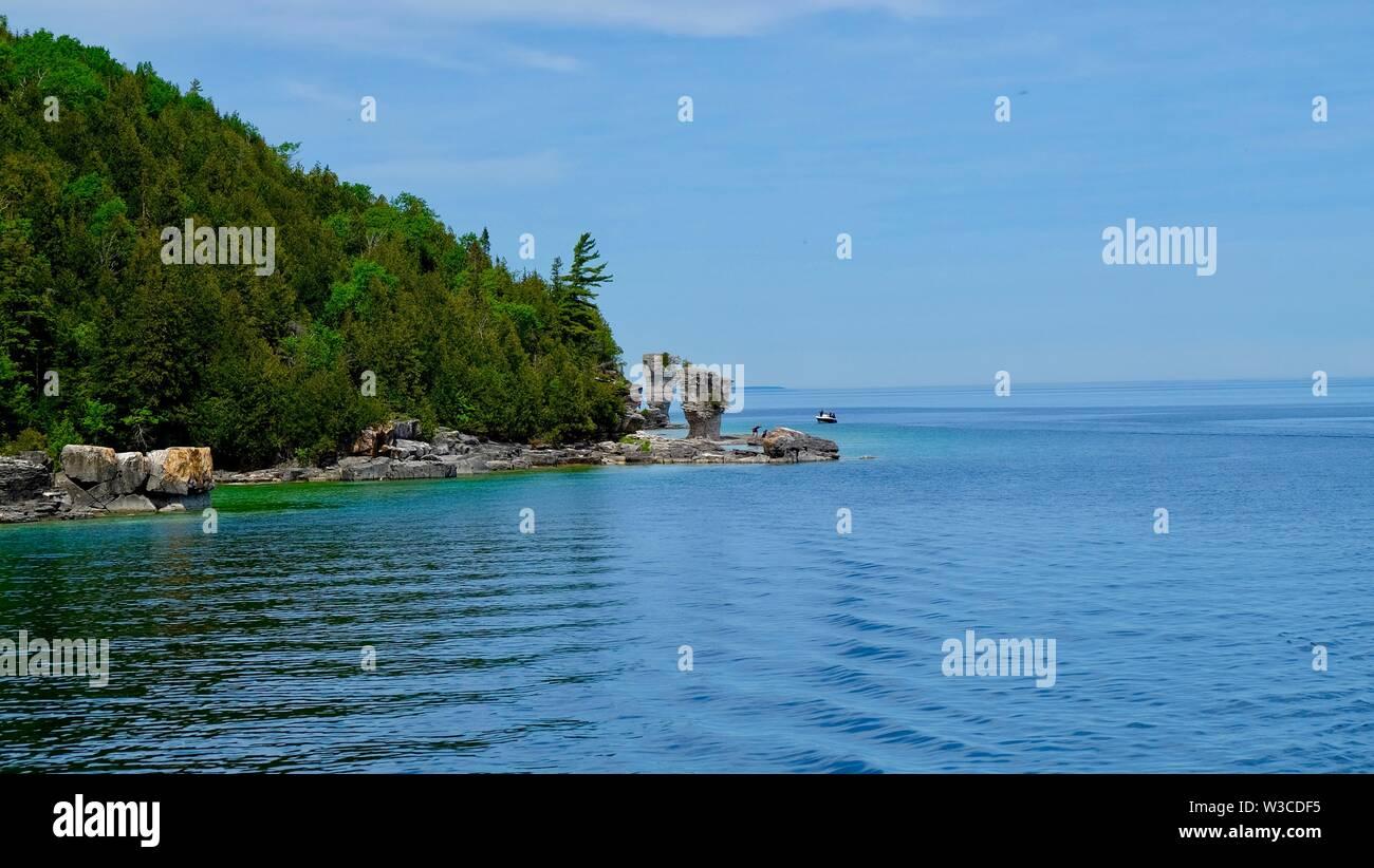 Bootsfahrt rund um den Blumentopf Insel Stockbild