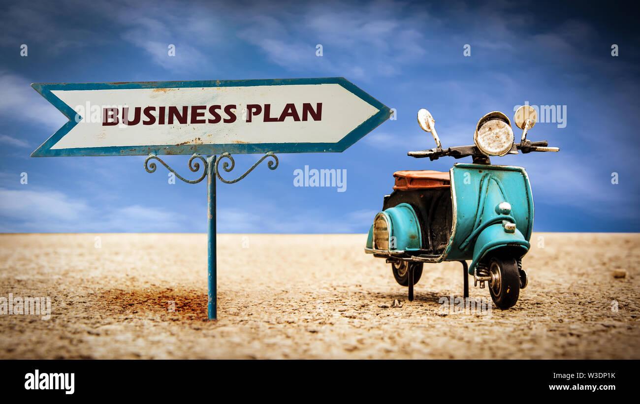 Straßenschild Richtung Weg zu Business Plan Stockbild