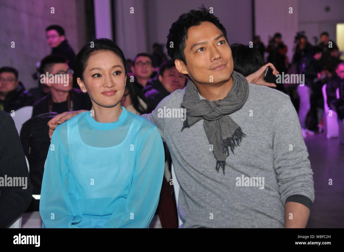 Chinesische Schauspielerin Zhou Xun, Front, und ihr amerikanischer Mann Archie Kao besuchen eine Premiere für die micro Film 'Dream Escape' zu Infini fördern Stockfoto
