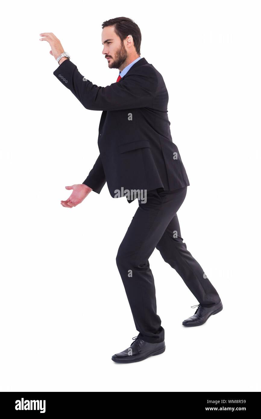 Geschäftsmann etwas mit seinen Händen auf weißem Hintergrund Stockfoto
