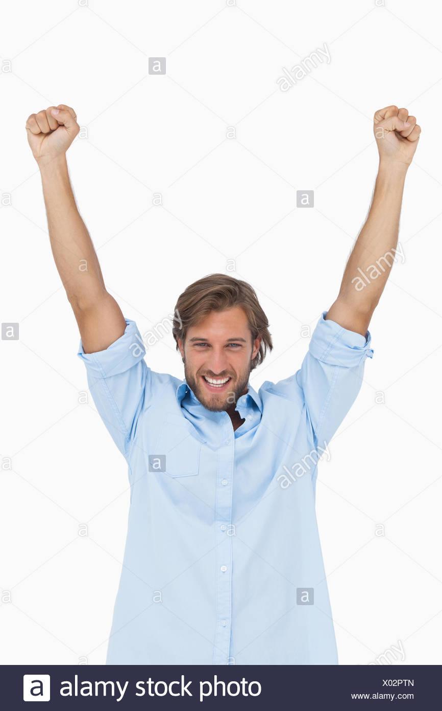Glücklicher Mensch feiert Erfolg mit Armen Stockbild