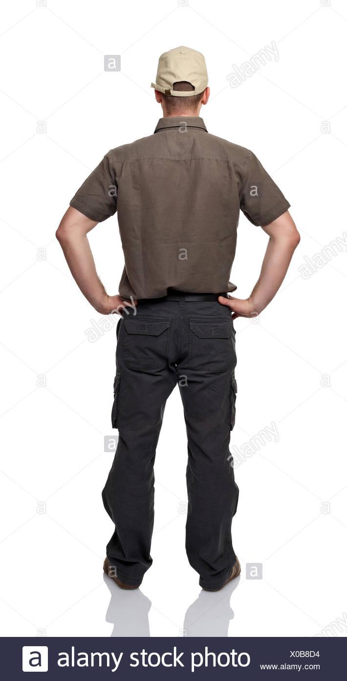 Blick Blick Blick spähen Rückblick auf einheitliche GAP beschäftigten Arbeiter Arbeiter Wageworker Mitarbeiter Mann hinten isoliert sehen Stockbild