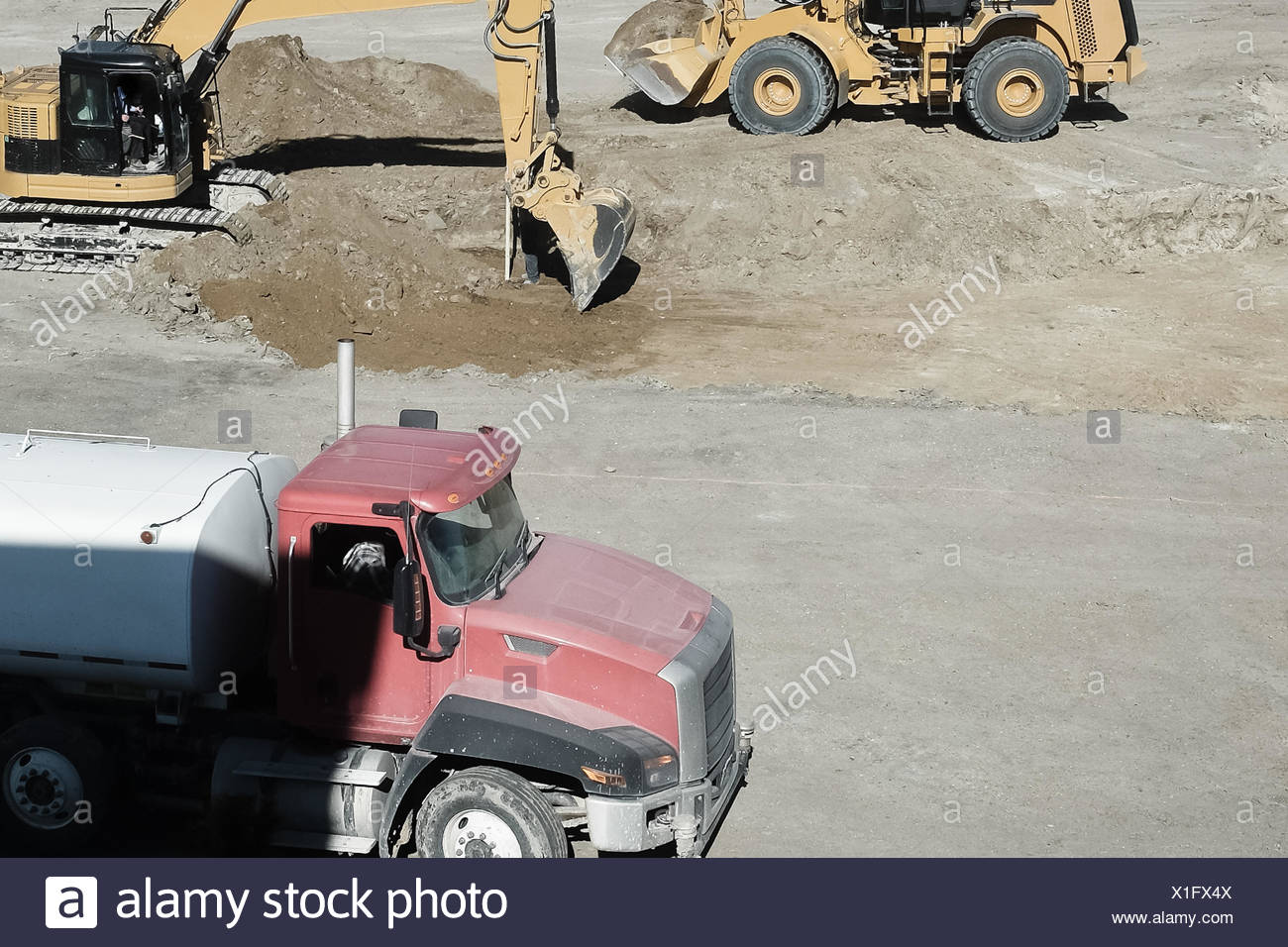 Baumaschinen auf Baustelle Stockbild