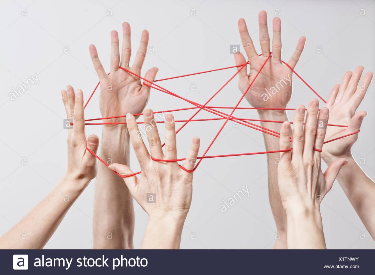 Verbindung, Team, Teamarbeit, Beziehung, Hände, Cat es Cradle Stockbild