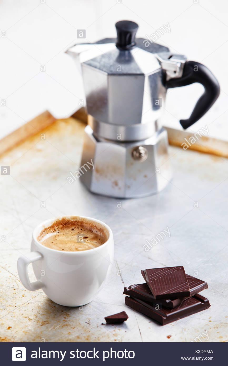 Espressotasse mit Schokolade Stockbild