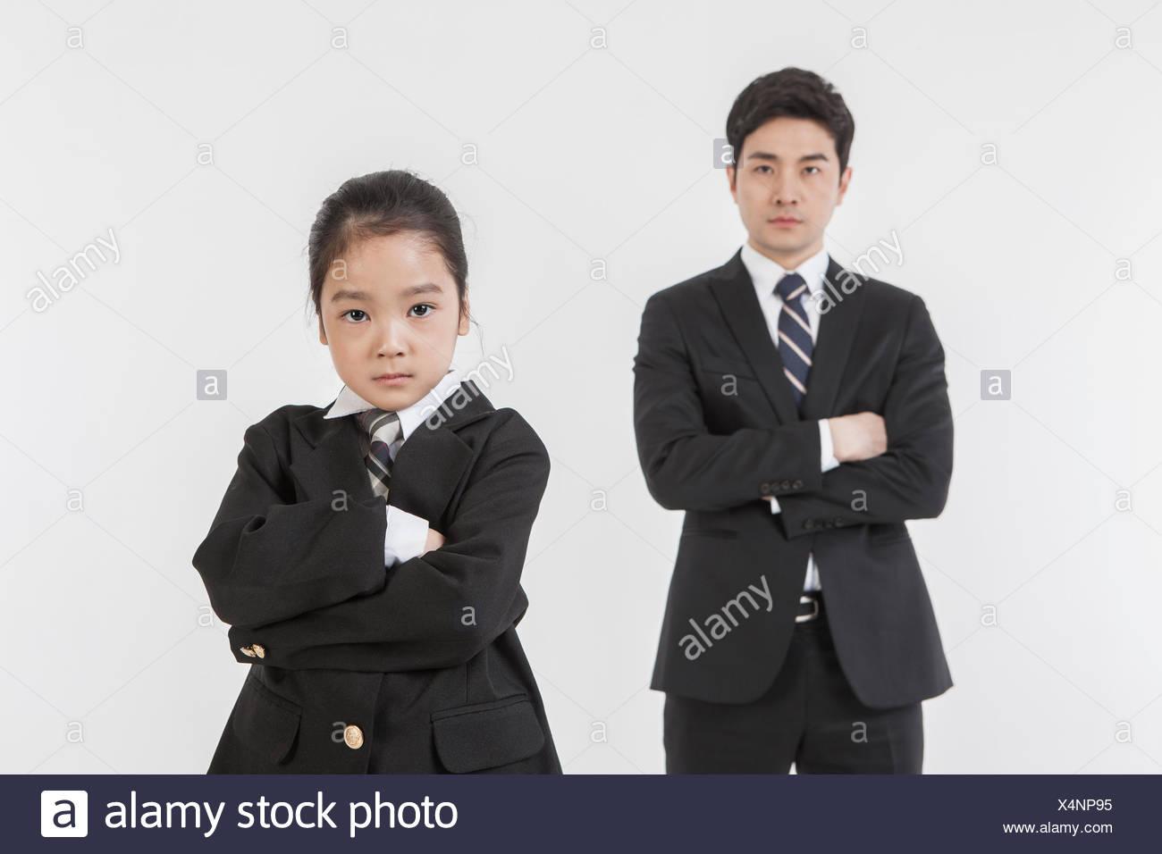 Geschäftsmann und seine Tochter Gelenkarme Stockbild