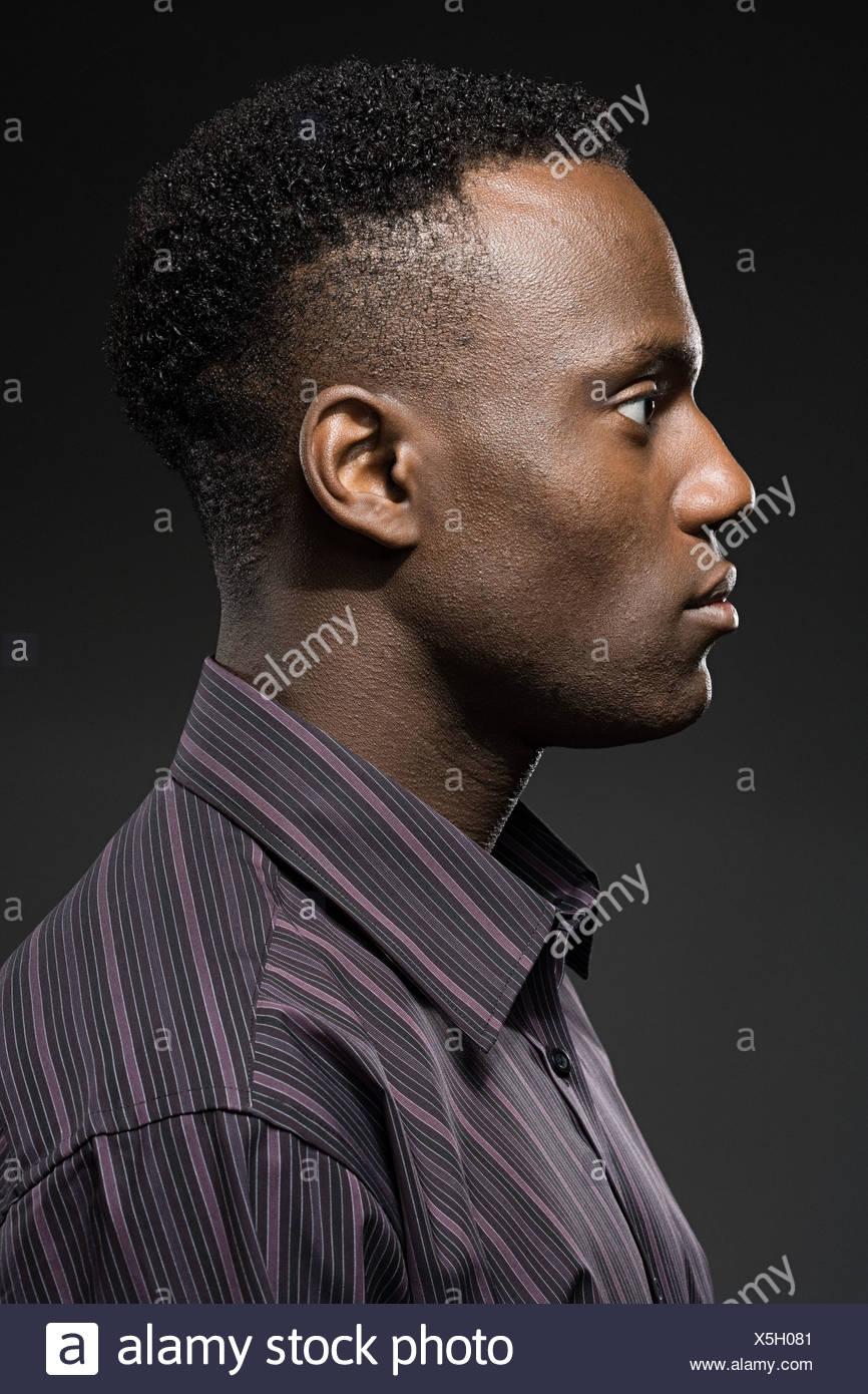 Profil eines jungen Mannes Stockbild